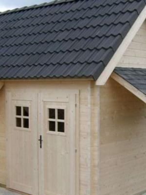 Houten cottage met afdak